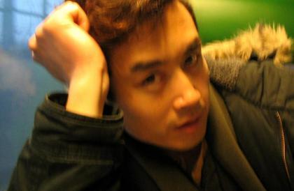Hu Xinyu Director.jpg